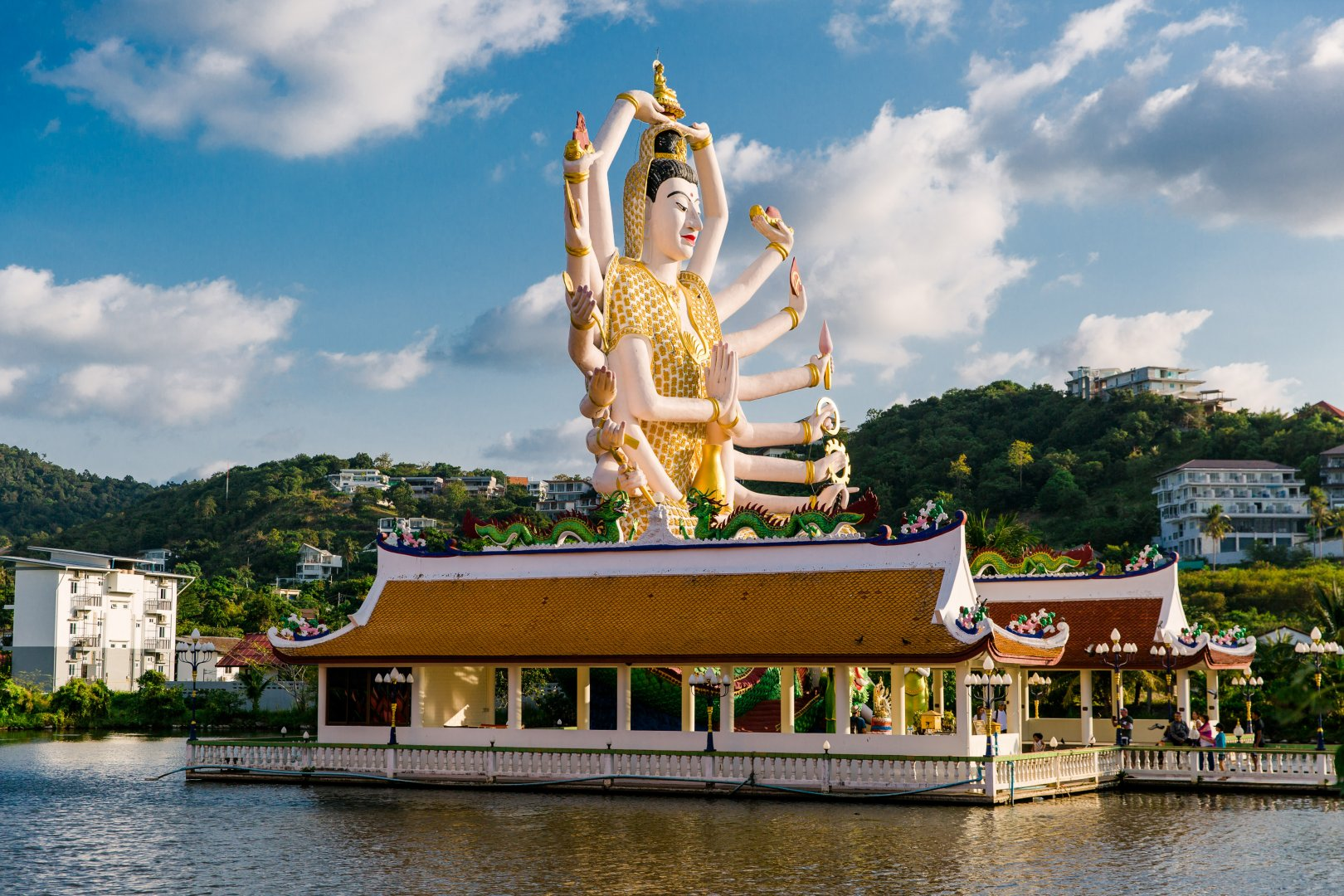 Statue Landmark Sky Temple Place of worship Hindu temple Architecture Temple Monument Wat Leisure Building Tourism Fictional character Vacation Shrine River World Tourist attraction Lake