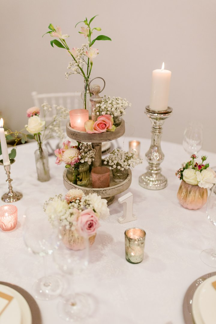 Centrepiece Pink Table Candle Flower Tableware Interior design Plant Tablecloth Peach Artificial flower Floral design Rose Interior design Floristry Cut flowers Wedding ceremony supply Peony Flower Arranging Dessert Furniture