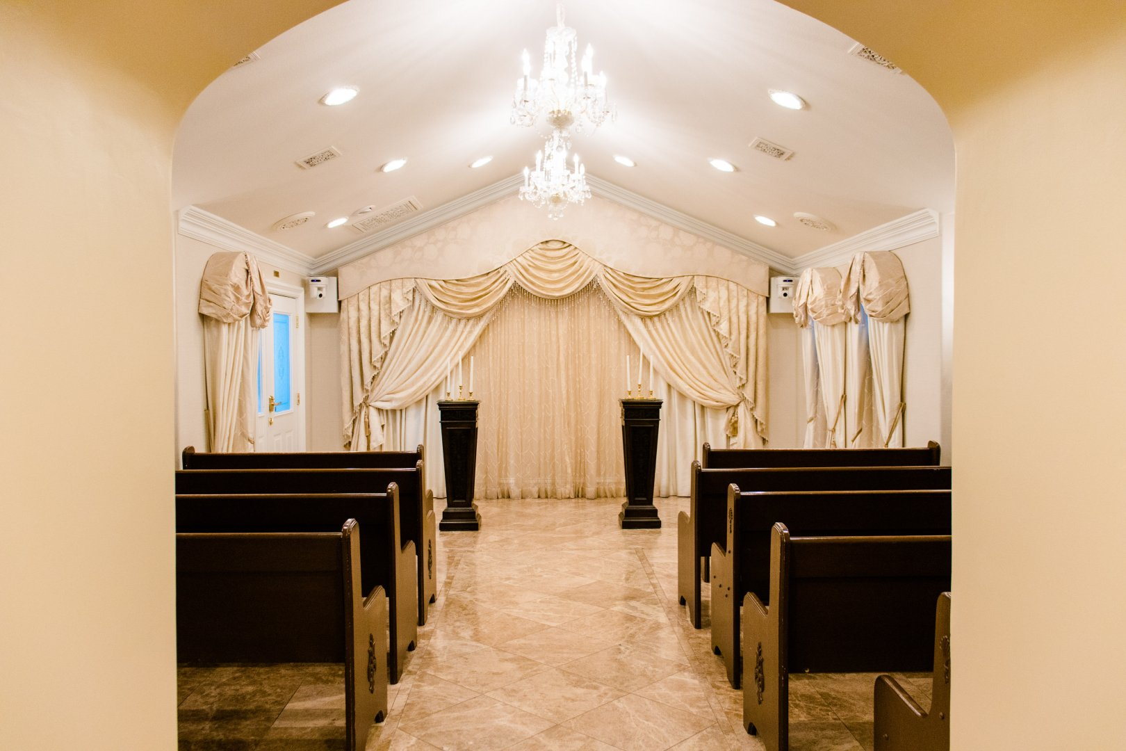Room Property Building Interior design Ceiling Arch Lighting Chapel Architecture Aisle Furniture Light fixture House Function hall Place of worship Hall Chandelier Interior design