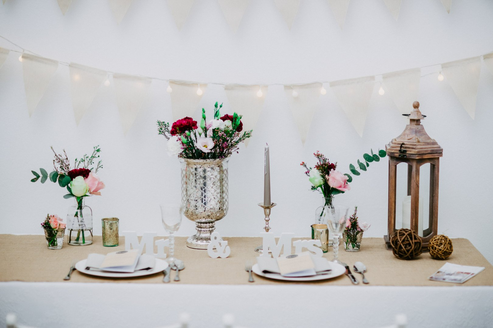 Decoration Photograph Pink Table Room Interior design Floral design Flower Floristry Tableware Textile Centrepiece Plant Event Furniture Branch Flower Arranging Wildflower Tablecloth Ceremony Peach Wedding reception Party Twig Rose