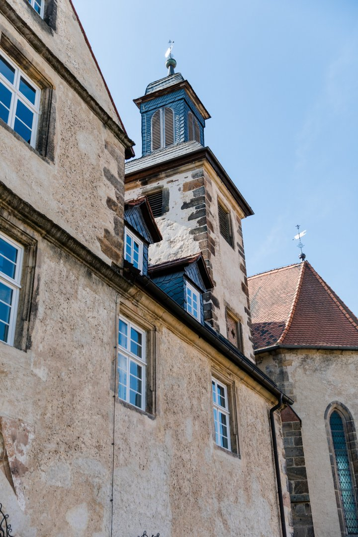 Building Architecture Town Wall Church Roof Medieval architecture Facade Steeple Sky House Bell tower Tree Tower Place of worship Convent Window City Clock tower Tourism Vacation Spire Parish