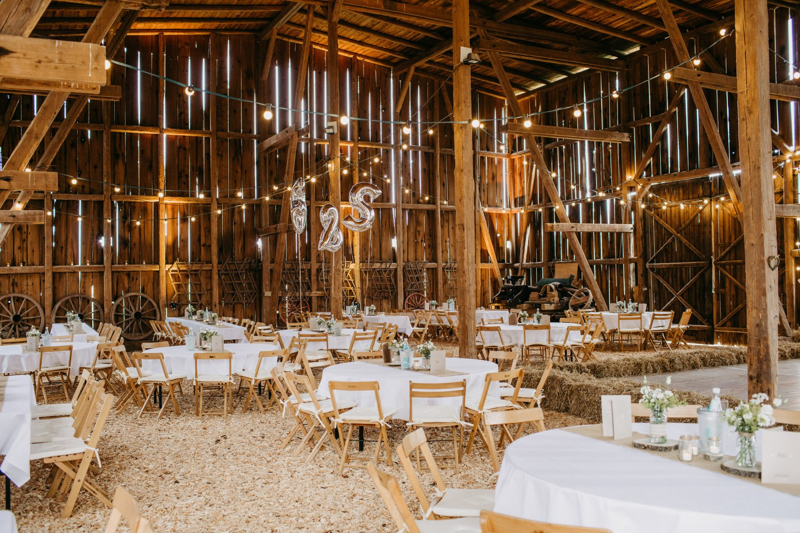 Chiavari chair Restaurant Function hall Lighting Room Chair Furniture Table Rehearsal dinner Interior design Building Architecture Wedding reception Plant Party House Ballroom Banquet