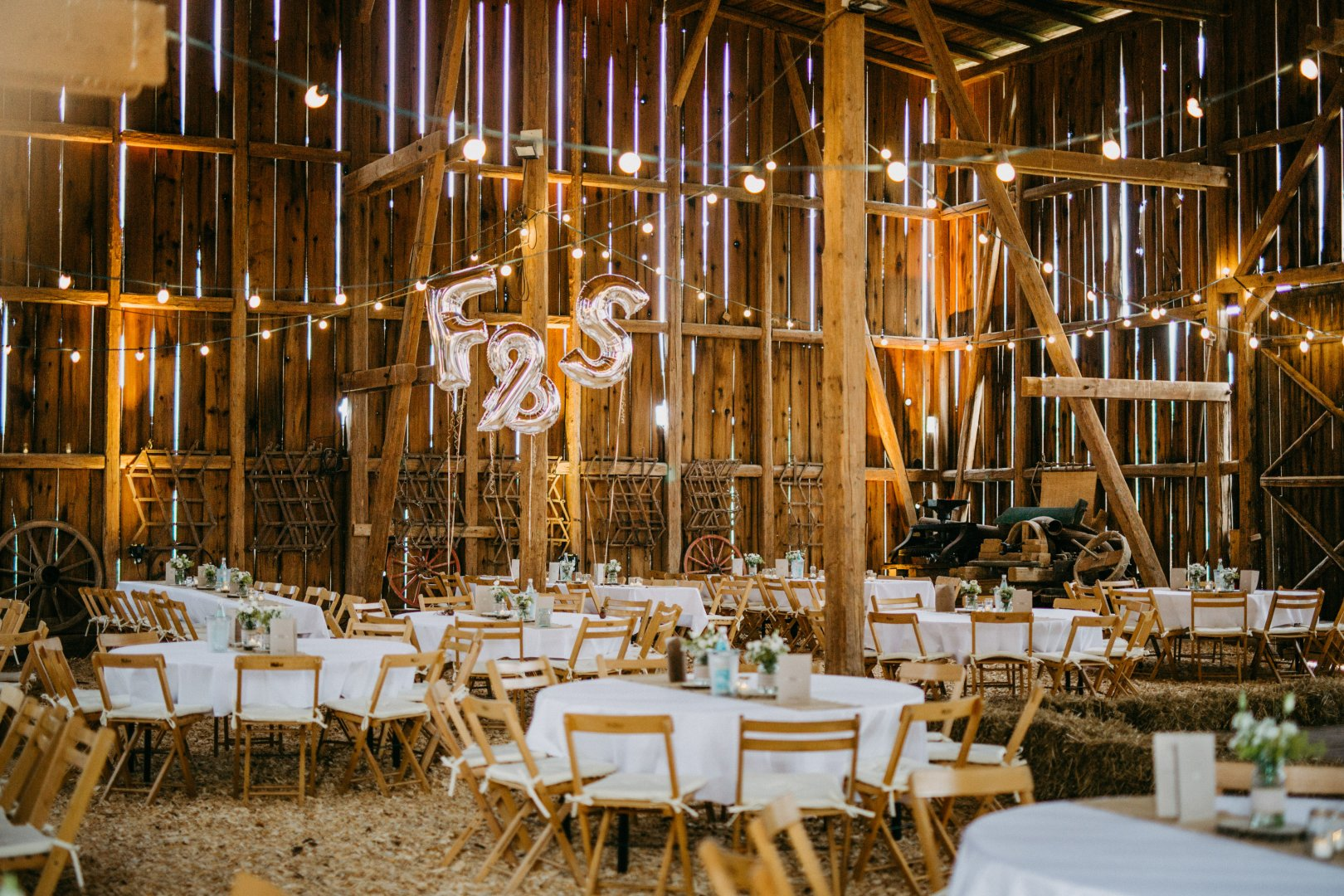 Chiavari chair Function hall Rehearsal dinner Restaurant Lighting Yellow Chair Table Room Interior design Party Ballroom Furniture Wedding reception Architecture Centrepiece Building Banquet Dining room
