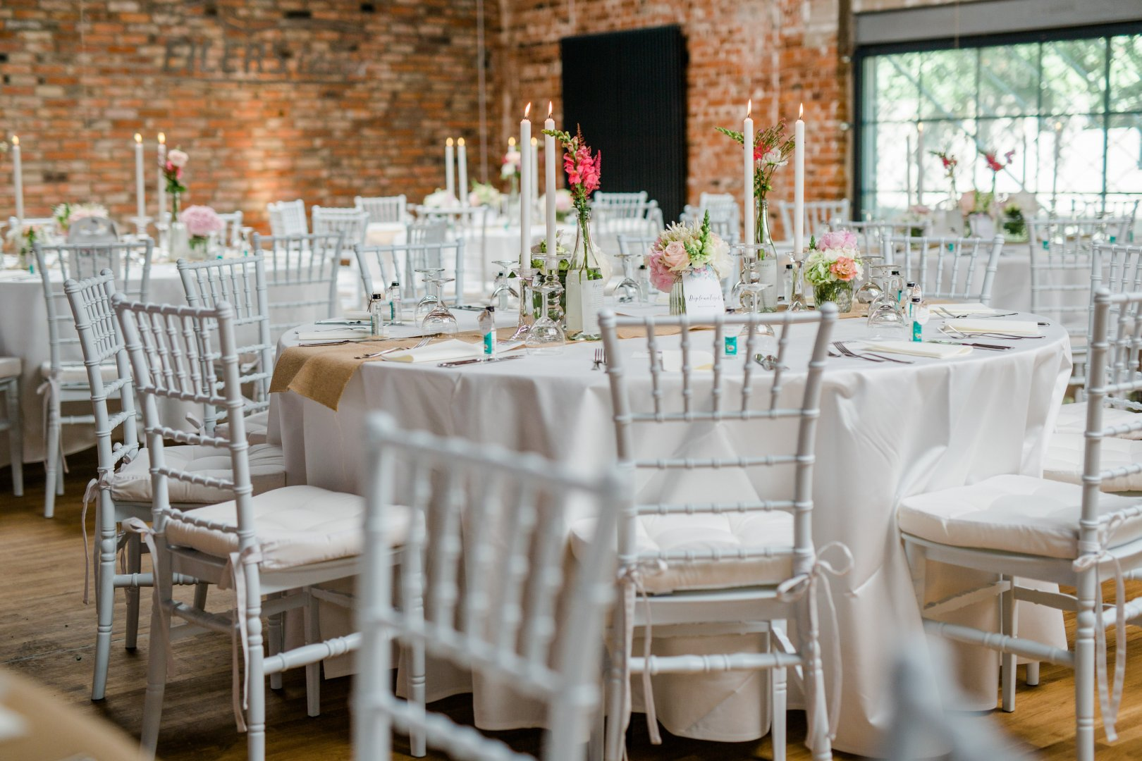 Chair Chiavari chair Wedding banquet Furniture Decoration Rehearsal dinner Table Tablecloth Wedding reception Room Restaurant Textile Function hall Event Flower Linens Ceremony Floral design Centrepiece Party Interior design Plant Banquet Floristry Flower Arranging