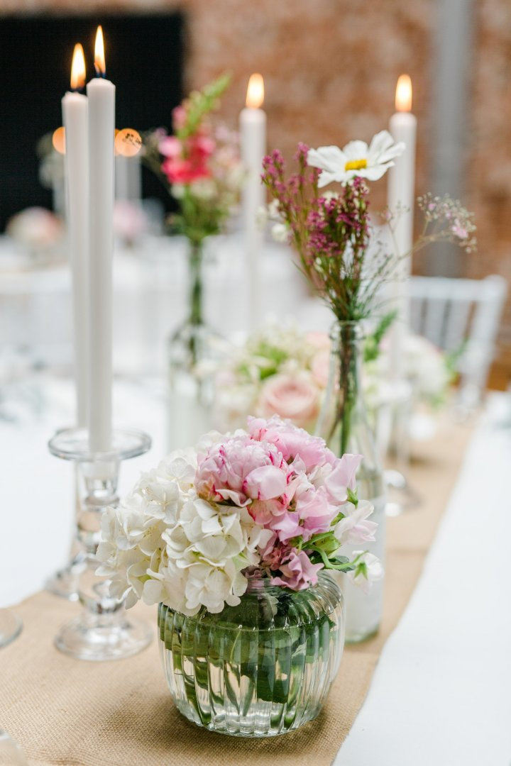 Centrepiece Flower Flower Arranging Floristry Candle Floral design Lighting Cut flowers Plant Pink Bouquet Interior design Tableware Table Wedding reception Artificial flower Room Peony Petal Rehearsal dinner Glass Vase Wildflower Ceremony Flowering plant Rose