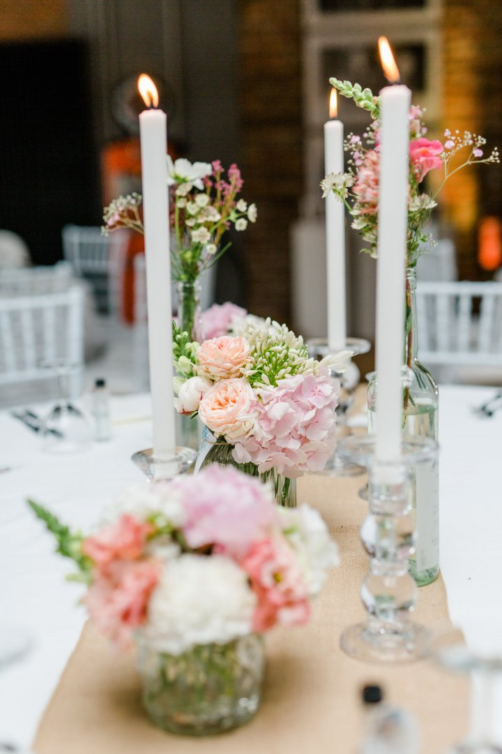 Centrepiece Candle Flower Arranging Floristry Floral design Lighting Pink Flower Wedding reception Cut flowers Tableware Interior design Plant Table Artificial flower Peony Unity candle Event Ceremony Petal Bouquet Interior design Peach Rehearsal dinner Glass Hydrangea Wedding ceremony supply
