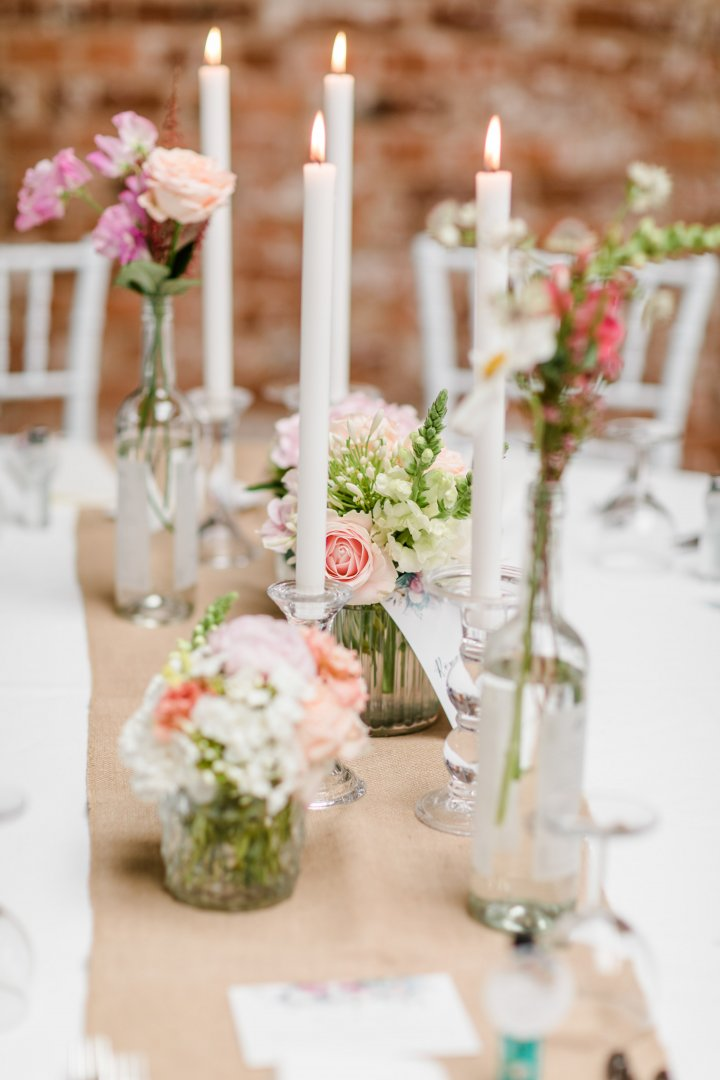 Candle Centrepiece Lighting Flower Arranging Floristry Floral design Tableware Flower Wedding reception Table Rehearsal dinner Interior design Event Plant Unity candle Decoration Textile Tablecloth Cut flowers Linens Candle holder Ceremony Wedding ceremony supply Peony Party