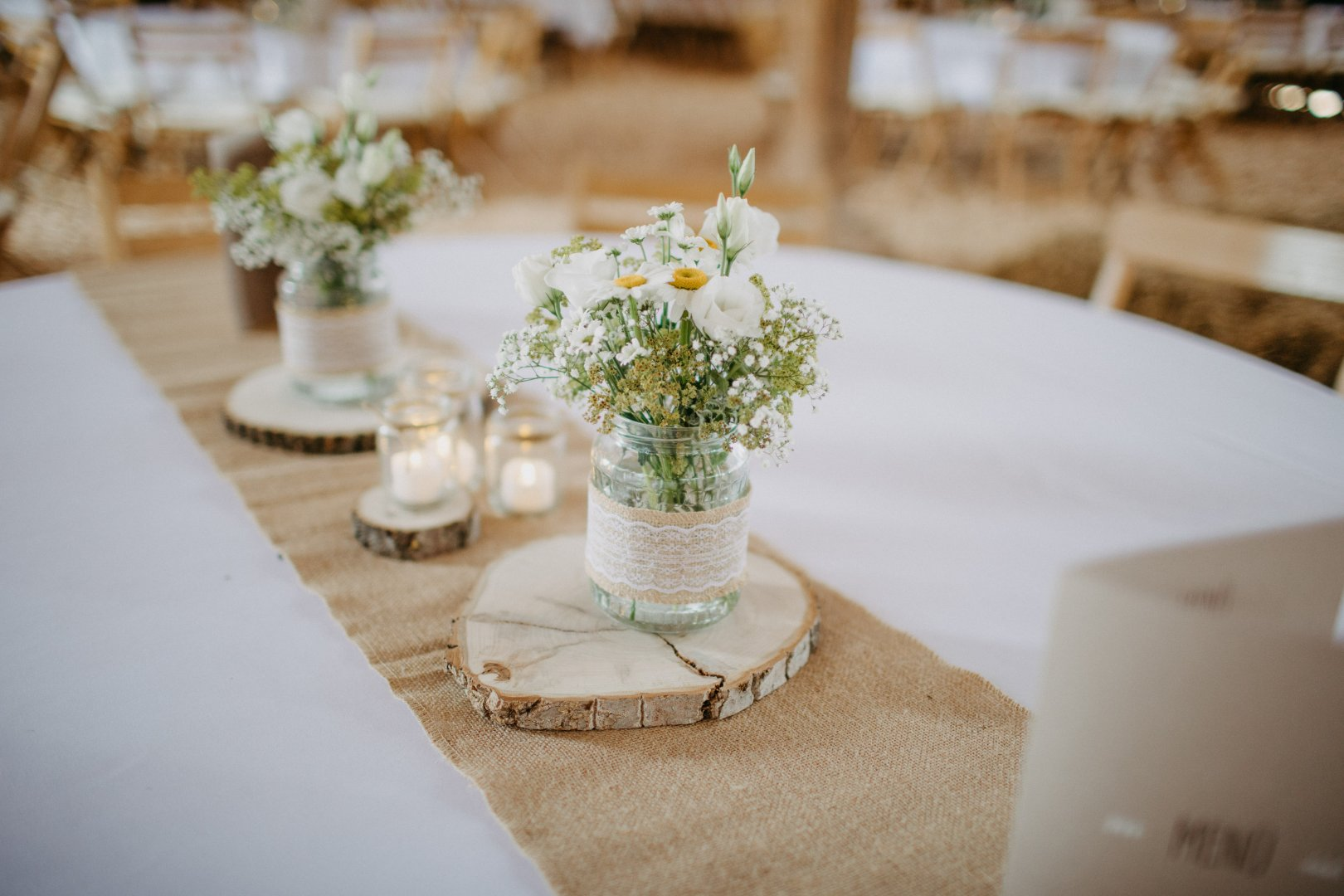 Centrepiece Photograph Tablecloth Table Yellow Rehearsal dinner Flower Textile Linens Restaurant Floral design Flower Arranging Floristry Plant Tableware Event Furniture Room Bouquet Ceremony Wildflower Interior design Wedding reception Banquet Interior design Cut flowers