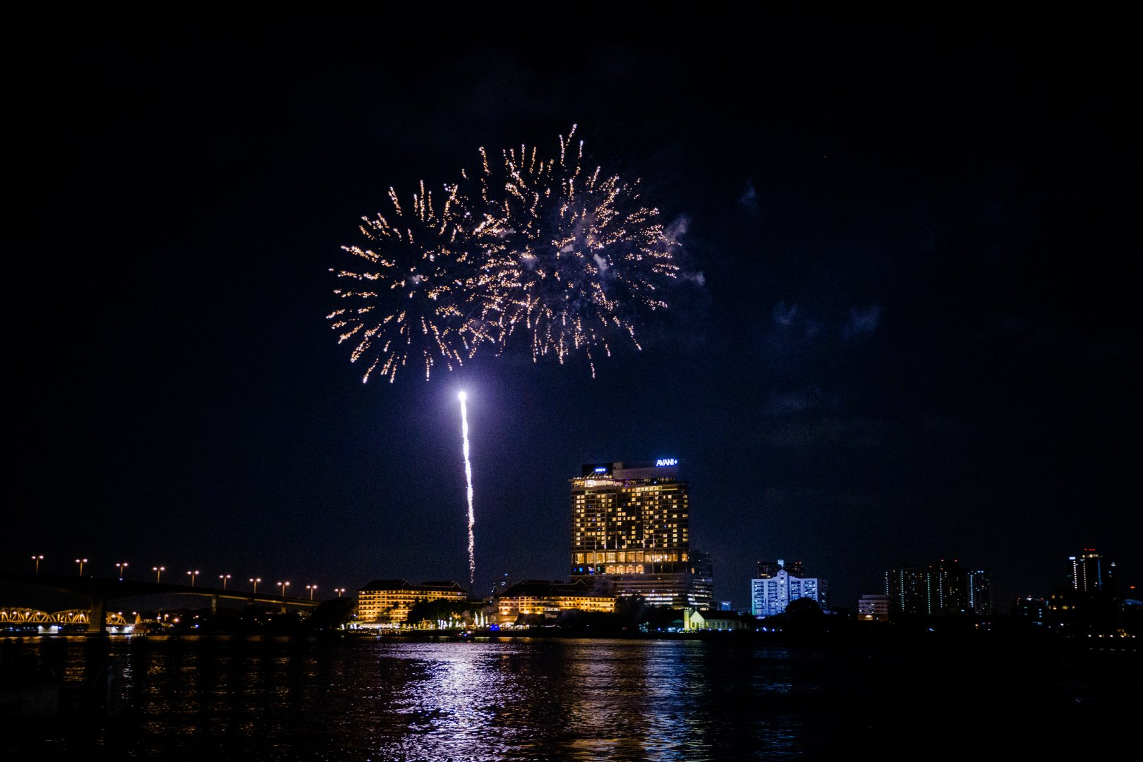 Fireworks Night New Years Day Sky Landmark River Midnight Metropolitan area Reflection Event Lighting City Holiday Architecture Darkness Urban area Recreation New year's eve Cityscape Waterway New year Festival Fête Downtown Independence day Metropolis Skyline Space Bank Harbor
