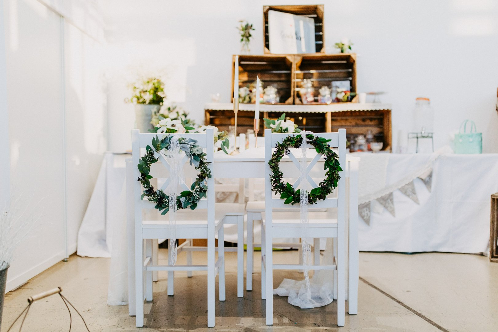 White Furniture Table Room Yellow Chair Interior design Dining room Textile Flower Event Plant Home Ceremony Floristry Houseplant House Shelf Tableware Party