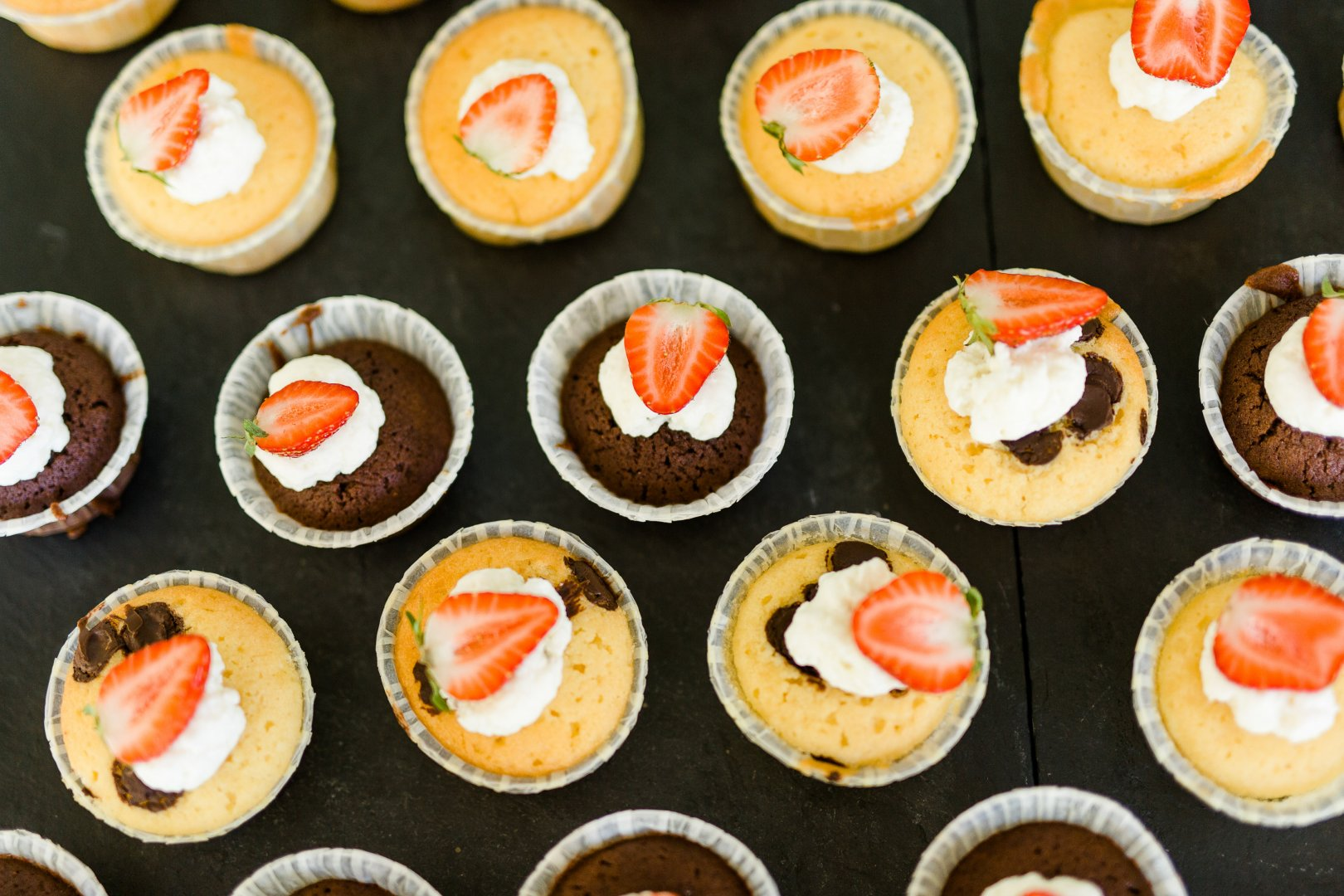 Dish Food Cuisine Cupcake Ingredient Dessert Buttercream Cream cheese Baking Icing Baked goods Candy corn Cake Finger food Cup Cream Canapé Produce Recipe Muffin Hors d'oeuvre Whipped cream Mascarpone Dairy appetizer Carrot cake