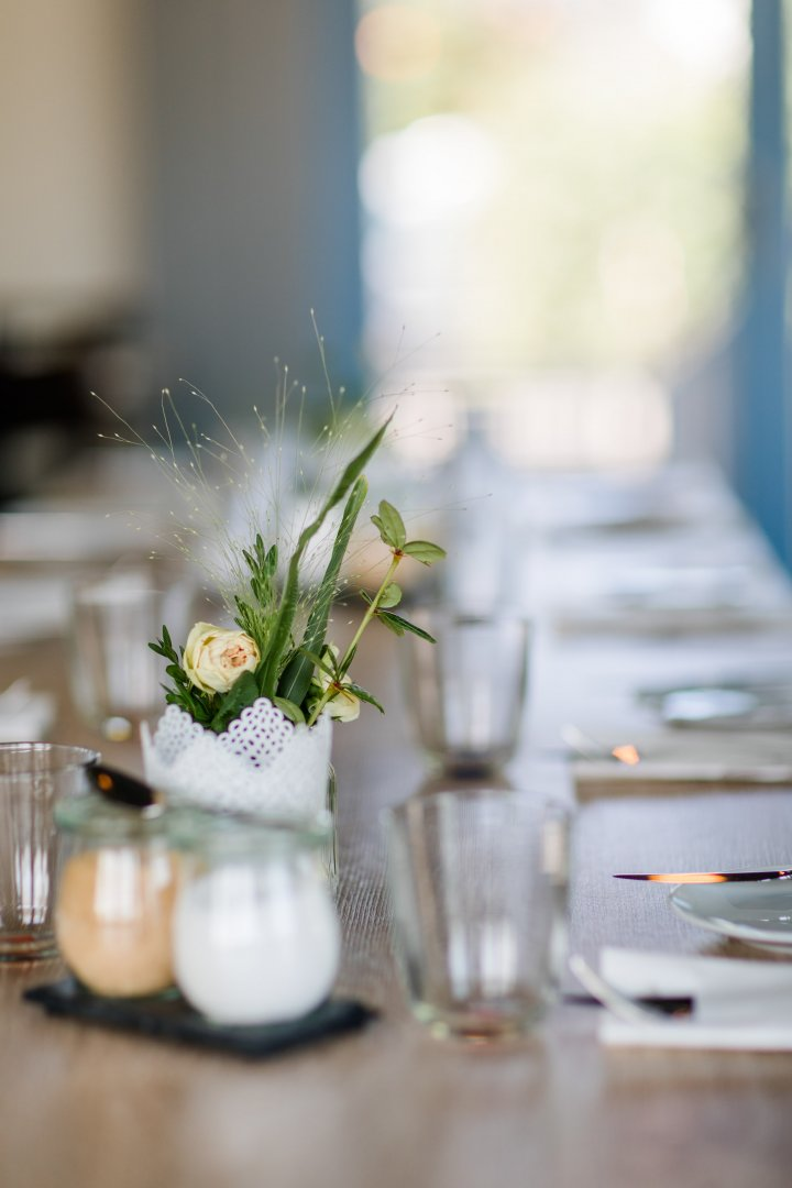 Photograph Green Yellow Centrepiece Flower Rehearsal dinner Table Plant Floral design Floristry Flower Arranging Tableware Glass Photography Ceremony Wedding reception Wildflower Restaurant