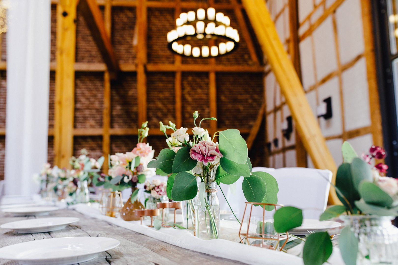 Photograph Green Rehearsal dinner Yellow Centrepiece Flower Floral design Floristry Chair Room Table Flower Arranging Wedding reception Plant Restaurant Event Interior design Window Ceremony Brunch Building Furniture House Glass Party Chiavari chair Tableware Function hall Wedding Meal
