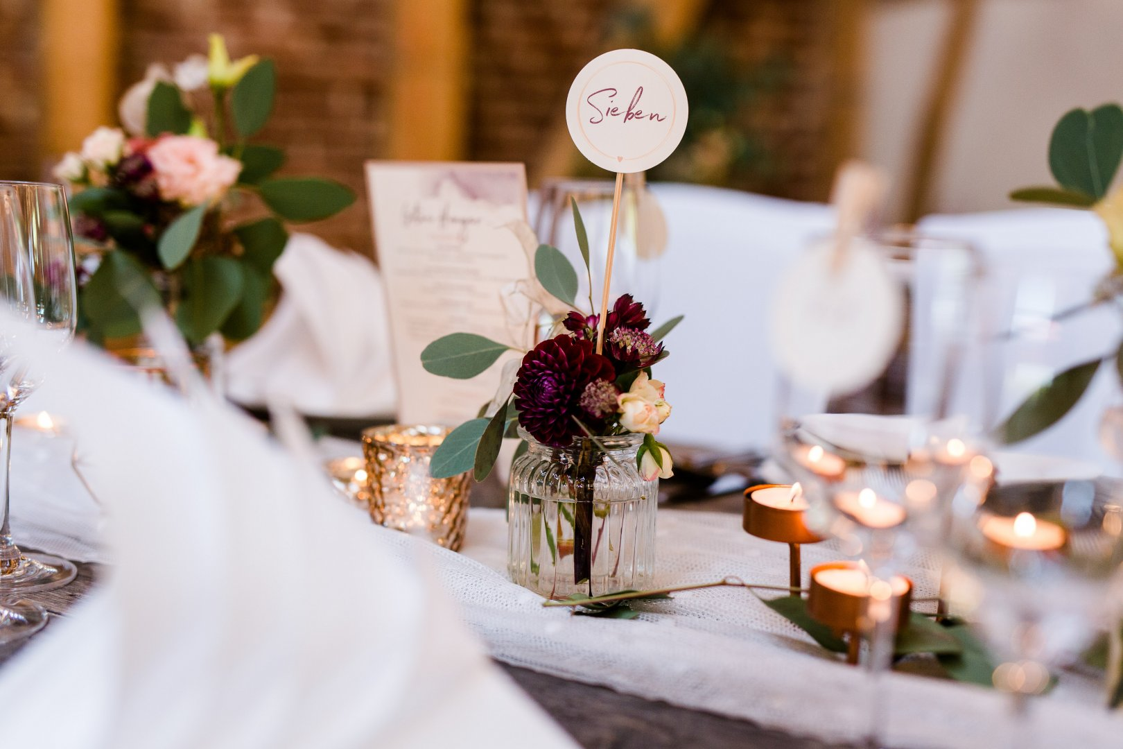 Photograph Centrepiece Rehearsal dinner Floral design Table Floristry Flower Flower Arranging Tableware Decoration Wedding reception Event Plant Meal Wedding banquet Wildflower Ceremony Tablecloth Party favor Candle Interior design Brunch Banquet Party