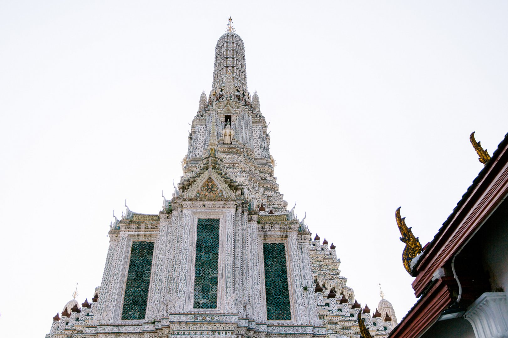 Landmark Spire Architecture Steeple Building Place of worship Temple Facade Tower Sky Wat Temple City Historic site Monument Tourist attraction Classical architecture Medieval architecture Tourism Church Cathedral Metropolis Vacation National historic landmark