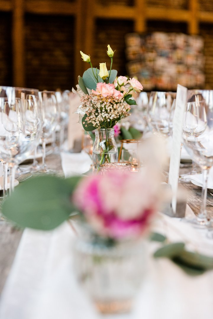 Wedding banquet Centrepiece Photograph Chiavari chair Decoration Pink Rehearsal dinner Table Yellow Flower Flower Arranging Floral design Wedding reception Floristry Chair Event Tableware Ceremony Furniture Plant Bouquet Textile Party Restaurant Function hall Tablecloth Linens Meal Interior design Petal