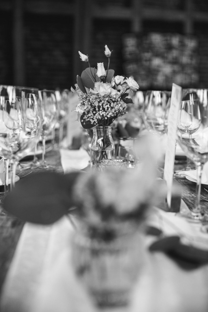 White Photograph Black-and-white Monochrome photography Monochrome Rehearsal dinner Centrepiece Flower Table Bouquet Photography Plant Event Tableware Ceremony Floral design Wedding reception Flower Arranging Chair Drinkware Style Party Floristry Furniture Wedding
