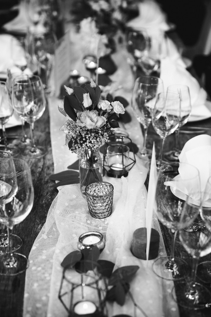 Photograph White Black-and-white Monochrome photography Rehearsal dinner Centrepiece Table Monochrome Ceremony Event Flower Wedding reception Champagne stemware Design Photography Stemware Textile Glass Wedding Tableware Banquet Wine glass Party Silver Bouquet Style Drinkware
