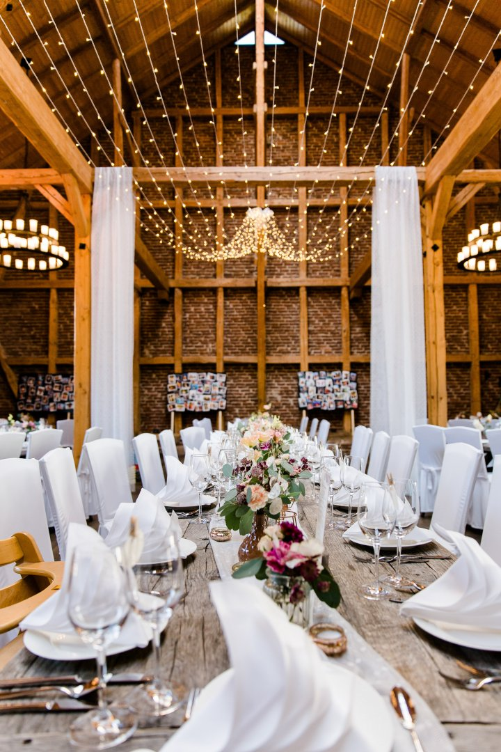 Wedding banquet Restaurant Rehearsal dinner Function hall Chiavari chair Chair Wedding reception Table Furniture Room Interior design Decoration Centrepiece Building Ceremony Banquet Tableware Party Event Textile Dining room Stemware Meal Tablecloth Linens Flower Wedding Brunch Ceiling Wine glass