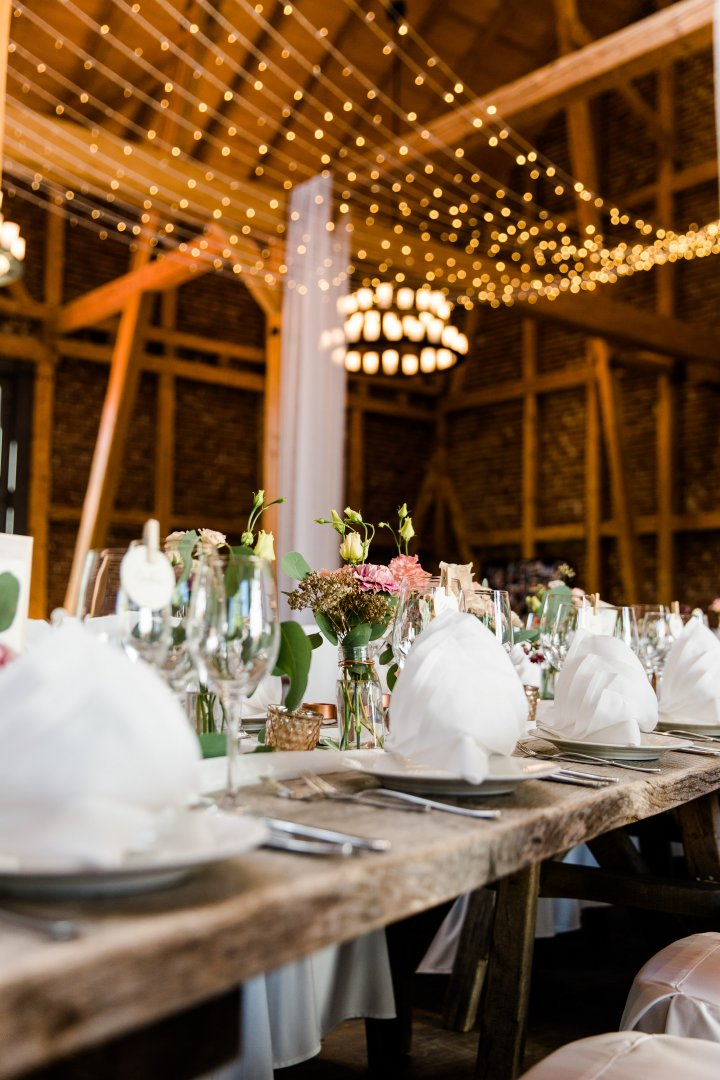 Wedding banquet Function hall Decoration Rehearsal dinner Restaurant Wedding reception Centrepiece Banquet Chiavari chair Event Chair Table Party Tablecloth Ceremony Furniture Building Linens Interior design Room Textile Tableware Flower Floral design Flower Arranging Meal Plant Floristry Ballroom