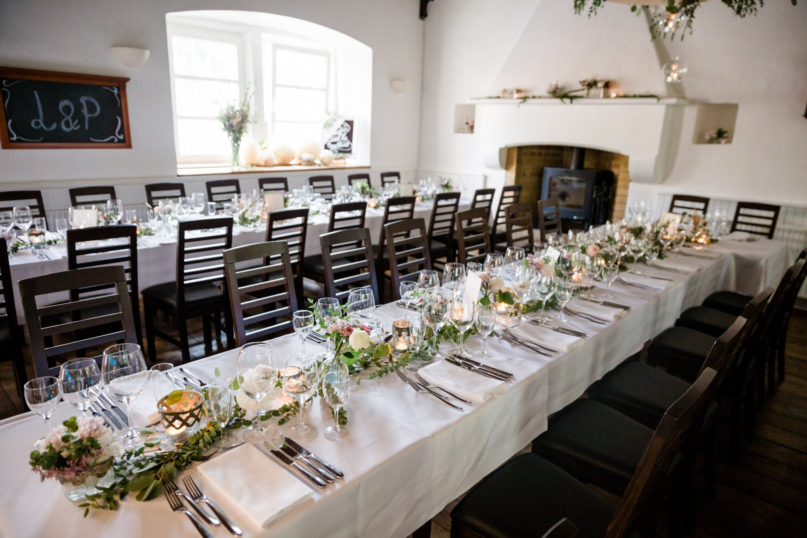 Rehearsal dinner Room Table Wedding reception Chiavari chair Restaurant Furniture Function hall Ceremony Event Interior design Chair Party Centrepiece Floristry Building Banquet Tablecloth Decoration Dining room Flower Linens Wedding