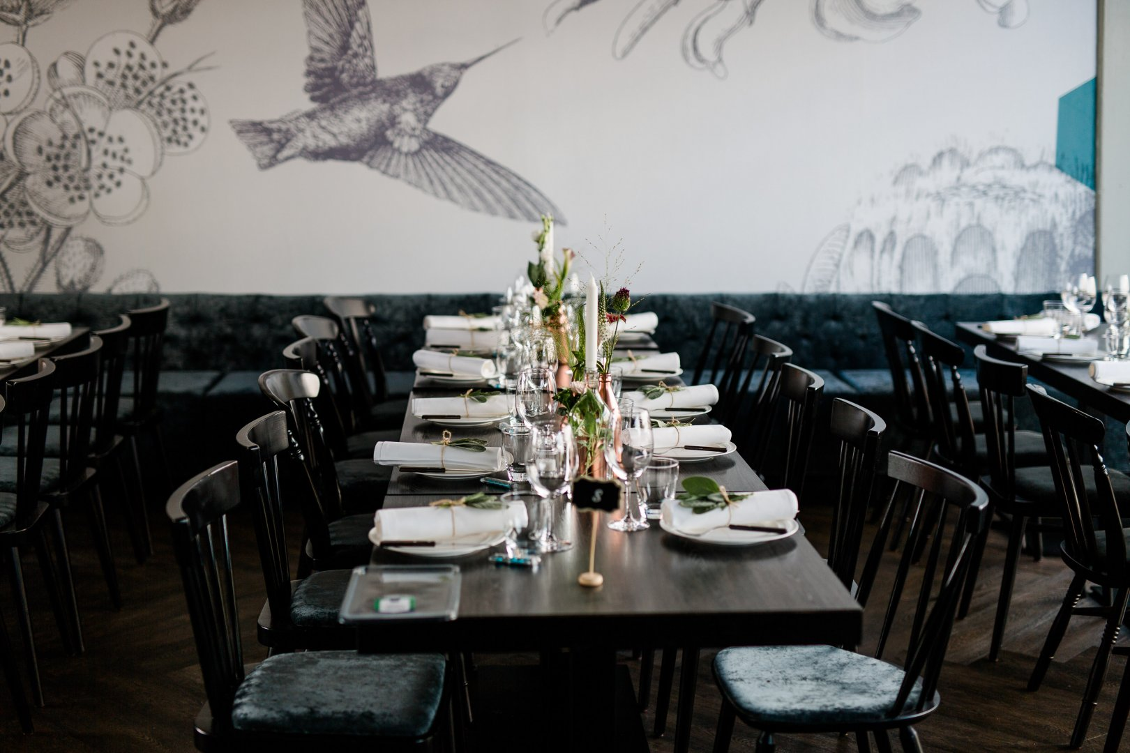 Restaurant Table Room Rehearsal dinner Chair Furniture Atmosphere Tree Textile Meal Event Interior design Plant Lunch Brunch Business Dining room Flower Organization Function hall Building Dinner