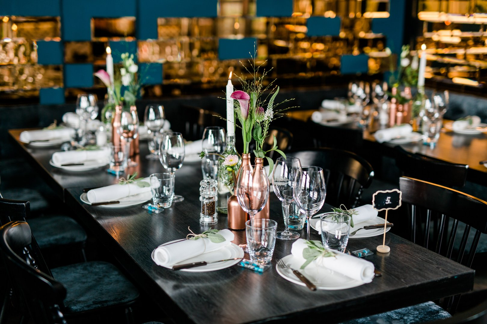 Rehearsal dinner Centrepiece Turquoise Table Restaurant Room Flower Banquet Event Wedding reception Textile Furniture Party Tableware Interior design Tablecloth Plant Function hall Meal Ceremony Floristry