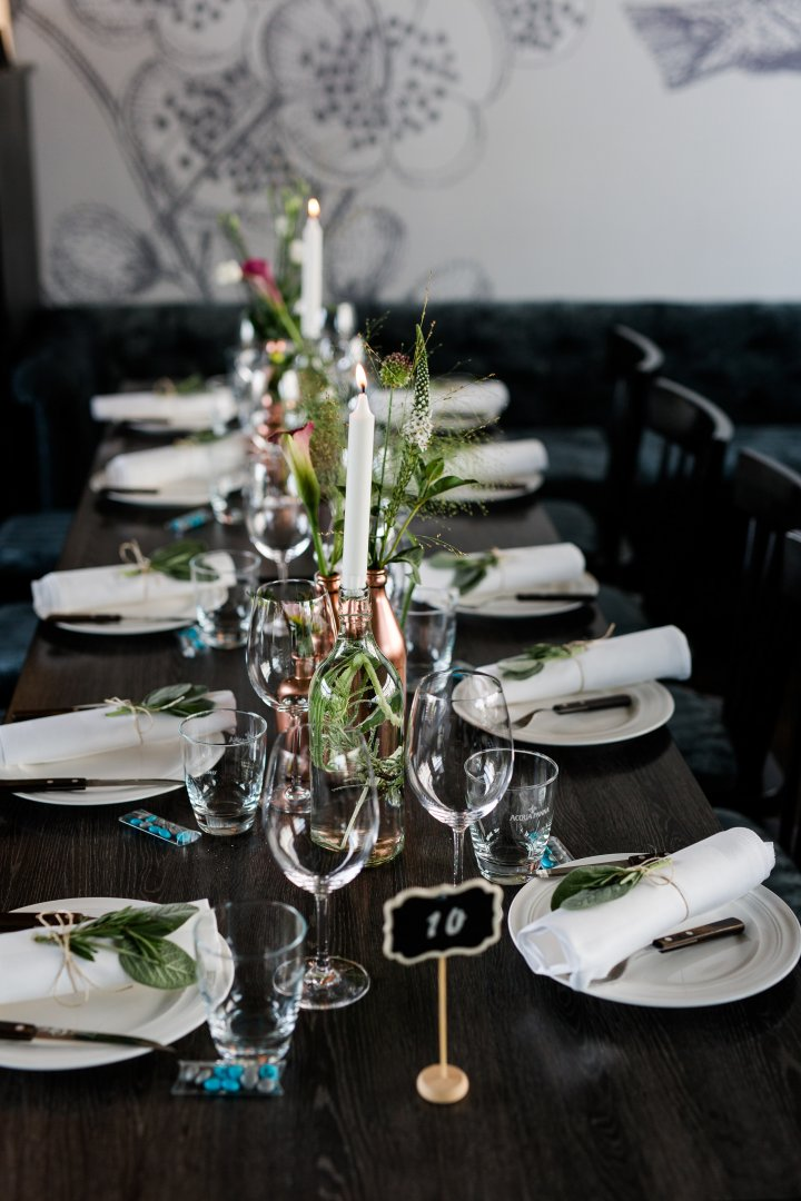 Green Rehearsal dinner Table Centrepiece Champagne stemware Restaurant Flower Floristry Room Tableware Plant Banquet Furniture Event Photography Stemware Meal Flower Arranging Glass Ceremony Wedding reception Floral design Party Still life photography