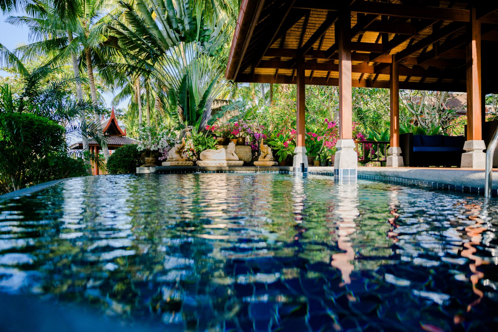 Swimming pool Resort Leisure Property Vacation Water Building Reflecting pool Tree House Real estate Hotel Palm tree Eco hotel Architecture Tropics Arecales Pond Leisure centre Villa Plant Resort town Home Hacienda Estate Tourism Spa town