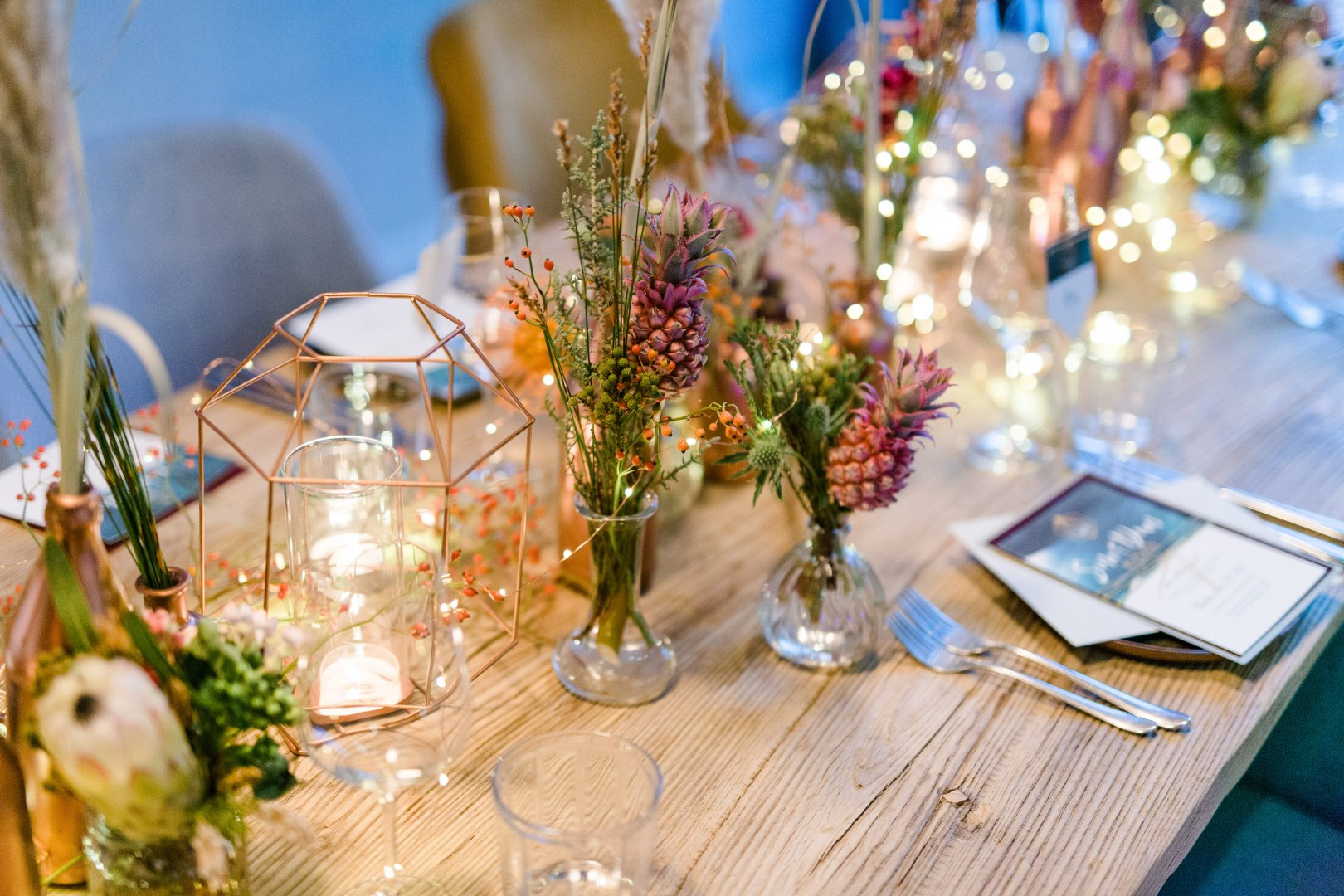 Lavender Flower Yellow Centrepiece Table Floral design Flower Arranging Rehearsal dinner Plant Floristry Wildflower Spring Tableware Champagne stemware Event Branch Glass Textile Wedding reception Bouquet Tablecloth Drinkware Cut flowers Ceremony Stemware Twig Party Interior design
