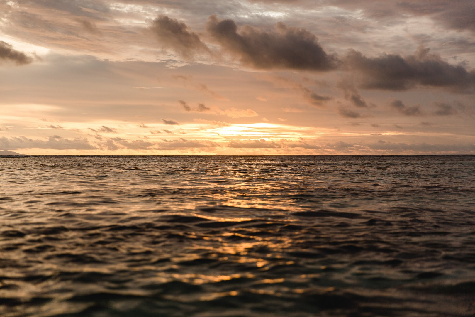 Sky Horizon Body of water Sea Water Nature Ocean Sunset Cloud Sunrise Evening Calm Afterglow Morning Dusk Wave Sound Reflection Atmosphere Sunlight Wind wave Coast Dawn Shore Vacation Beach Photography Cumulus Red sky at morning Stock photography