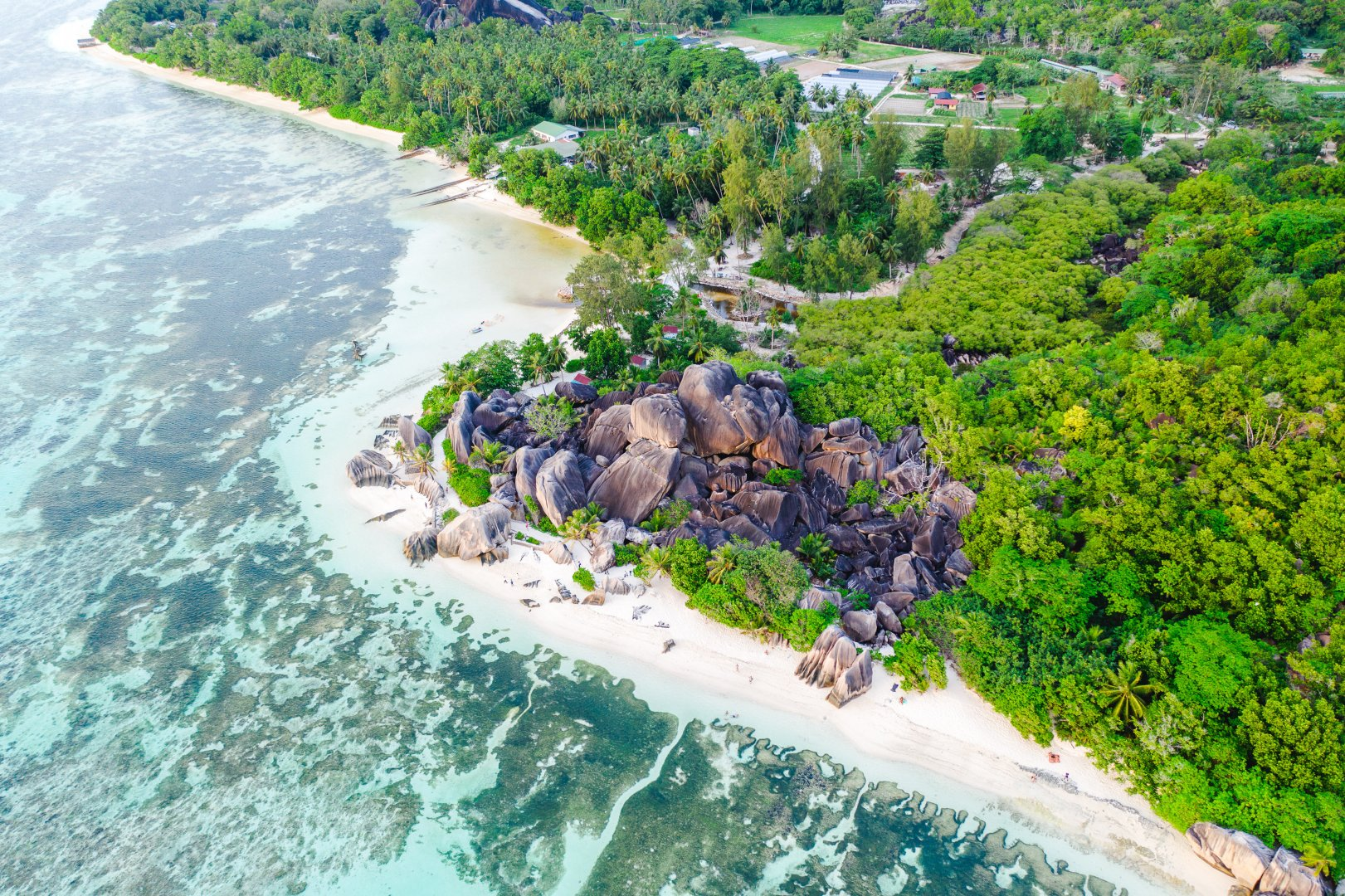 Aerial photography Natural landscape Coast Water resources Coastal and oceanic landforms Shore Bird's-eye view Real estate Photography Tropics Beach Landscape Estate Sea Island Bay Geological phenomenon Vacation Cape Promontory Cay Inlet Resort River island Tourism