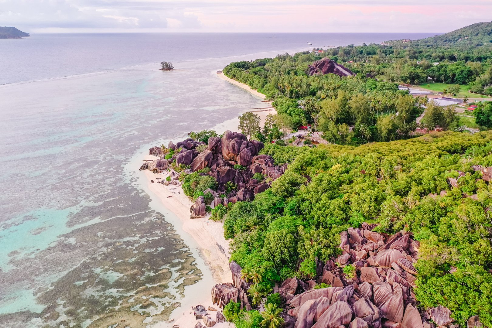 Body of water Coast Natural landscape Sea Vegetation Shore Coastal and oceanic landforms Beach Promontory Headland Water Bay Cliff Ocean Sky Tourism Landscape Rock Aerial photography Cape Terrain Klippe Tropics Vacation Inlet River Hill Bank National park Cove