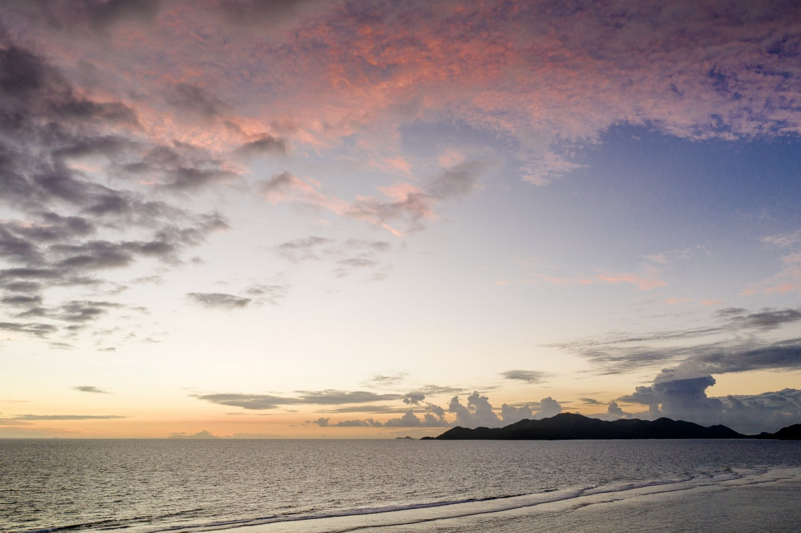 Sky Horizon Cloud Body of water Sea Afterglow Ocean Daytime Sunset Cumulus Morning Calm Evening Sunrise Atmosphere Sound Coast Water Dusk Sunlight Dawn Shore Landscape Meteorological phenomenon Beach Wind wave Coastal and oceanic landforms Vacation Photography Wave