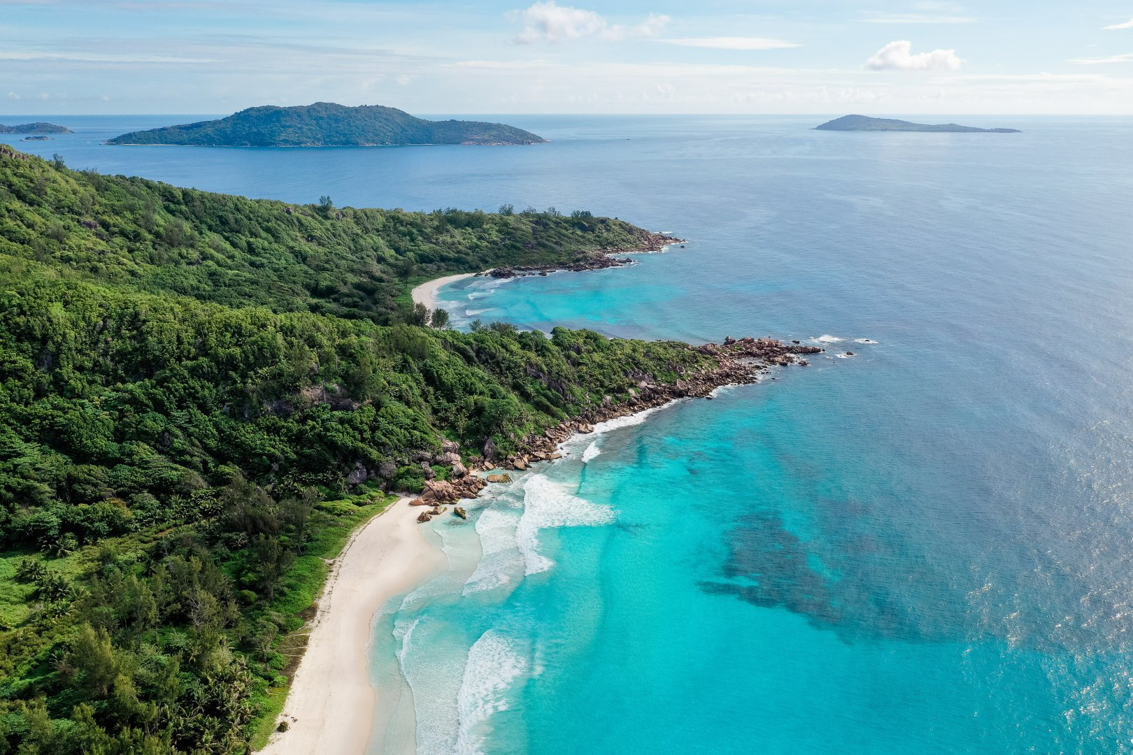 Body of water Coast Natural landscape Coastal and oceanic landforms Water resources Promontory Sea Headland Bight Inlet Bay Water Tropics Peninsula Cape Ocean Cove Lagoon Shore Archipelago Island Islet Caribbean Aerial photography Sound Tourism Vacation Cay Landscape Tourist attraction