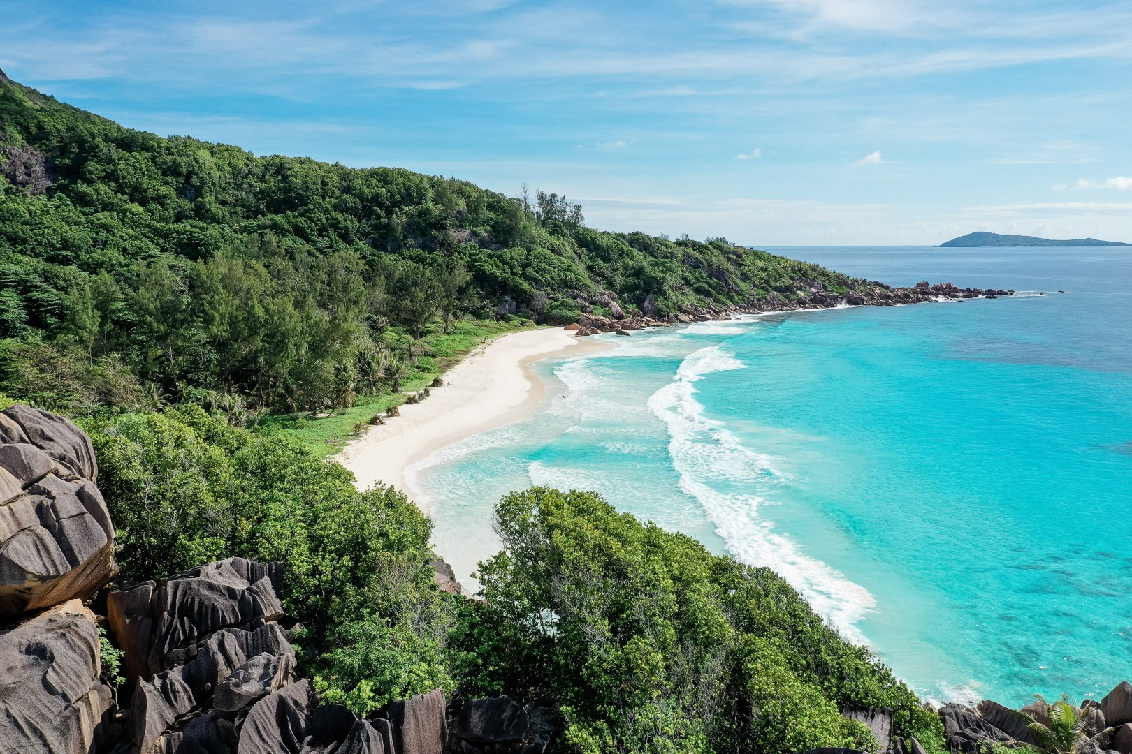 Body of water Coast Nature Beach Sea Shore Natural landscape Coastal and oceanic landforms Vegetation Water Ocean Bay Promontory Tropics Sky Cove Turquoise Headland Water resources Vacation Bight Inlet Tourism Tree Cape Summer National park Landscape Caribbean Rock