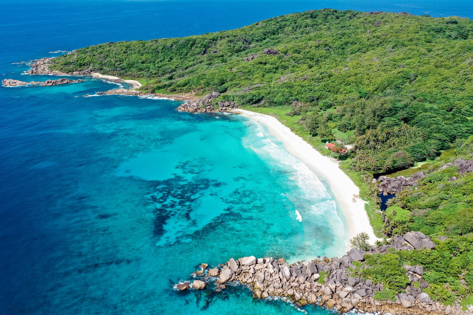 Body of water Coast Sea Coastal and oceanic landforms Bight Promontory Shore Bay Natural landscape Headland Ocean Beach Inlet Cove Cape Water resources Water Tropics Aerial photography Peninsula Vacation Tourism Klippe Photography Cliff Landscape National park Rock Lagoon Caribbean