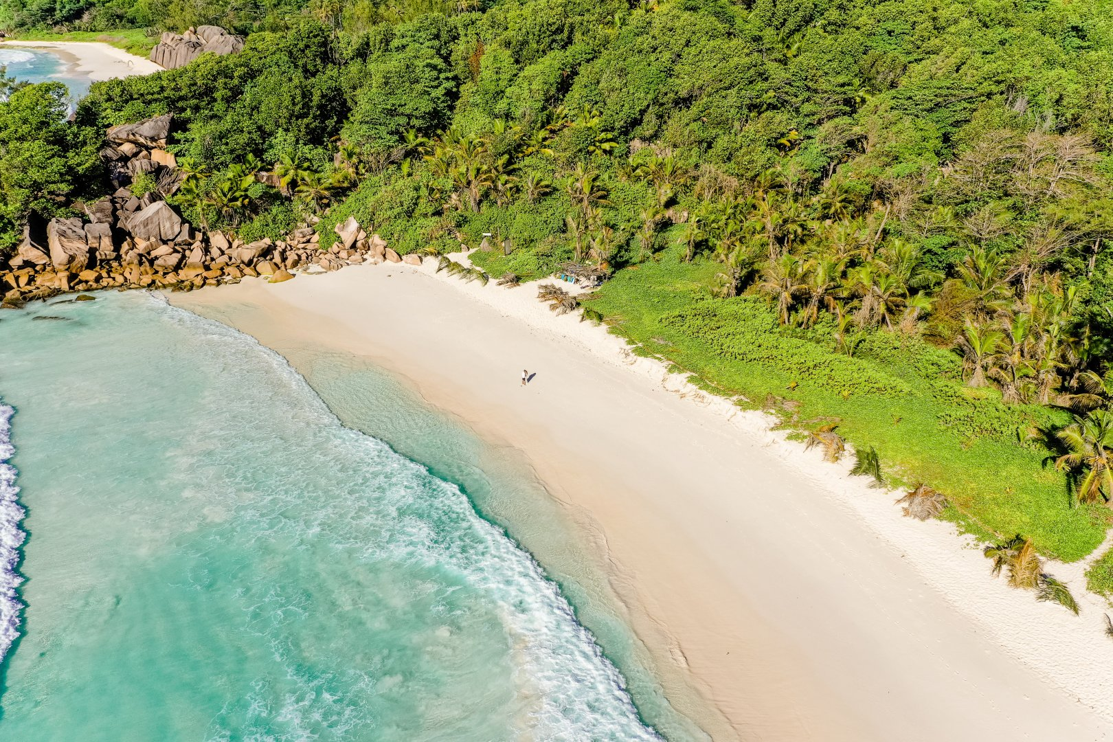 Body of water Coast Beach Shore Coastal and oceanic landforms Sea Water resources Bay Tropics Promontory Water Aerial photography Inlet Sand Cove Tree Ocean Vacation Headland Cape Bight Photography Tourism Watercourse Caribbean Landscape National park Plant Bank Wave