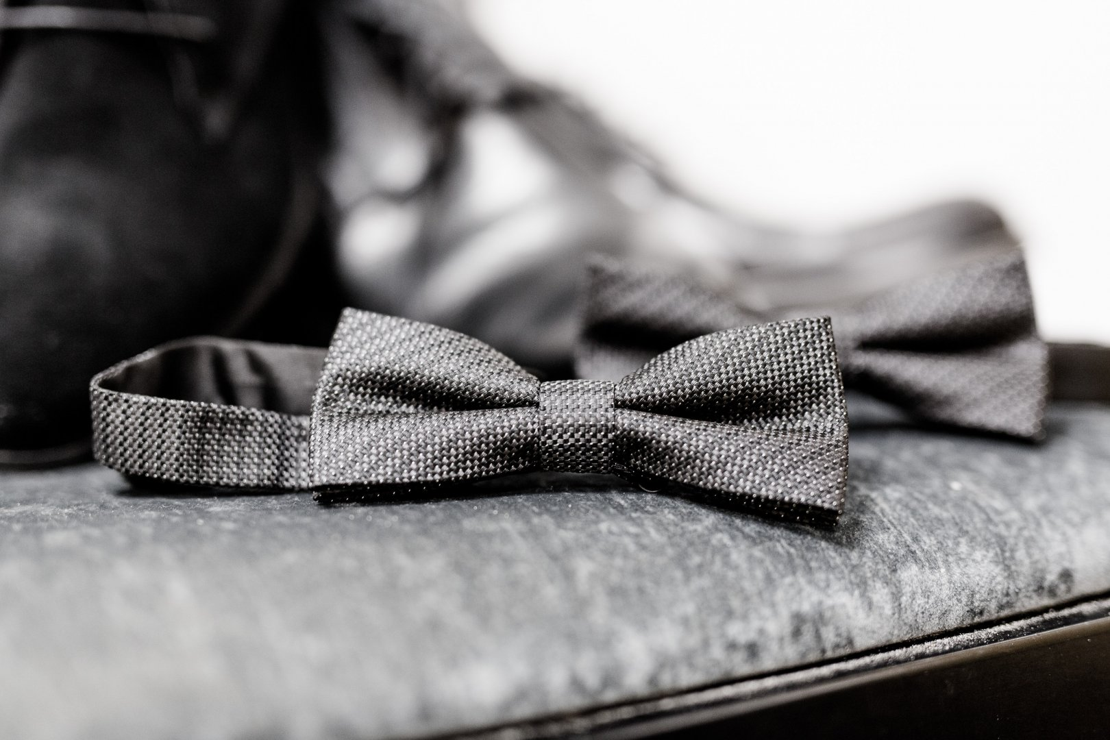 White Black Bow tie Tie Plaid Pattern Footwear Fashion accessory Black-and-white Design Photography Textile Tartan Shoe Formal wear Monochrome Still life photography Style