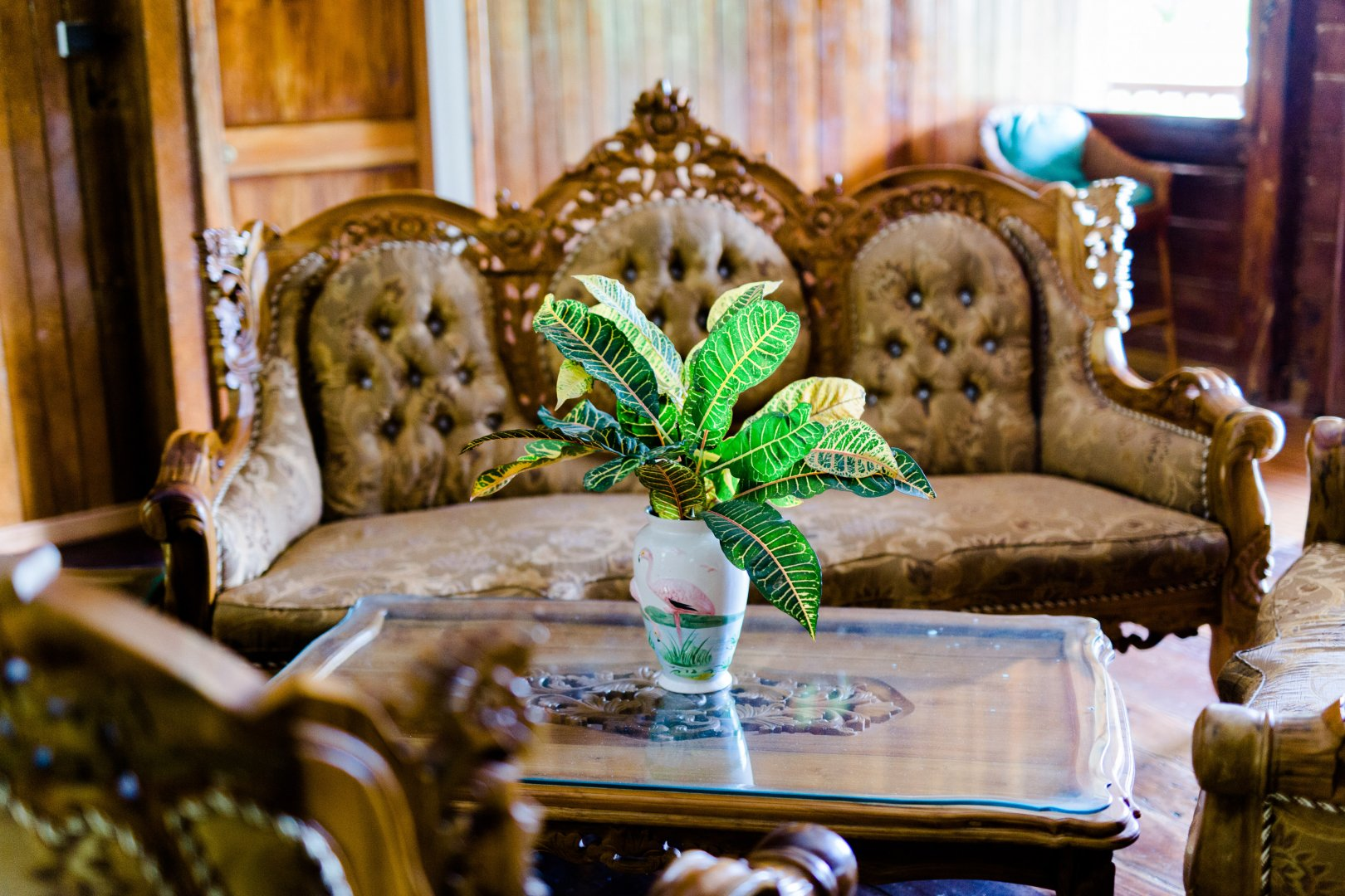 Furniture Green Room Couch Living room Chair Interior design Turquoise Table Classic Loveseat House Architecture Plant Still life Wood Home Antique Flower
