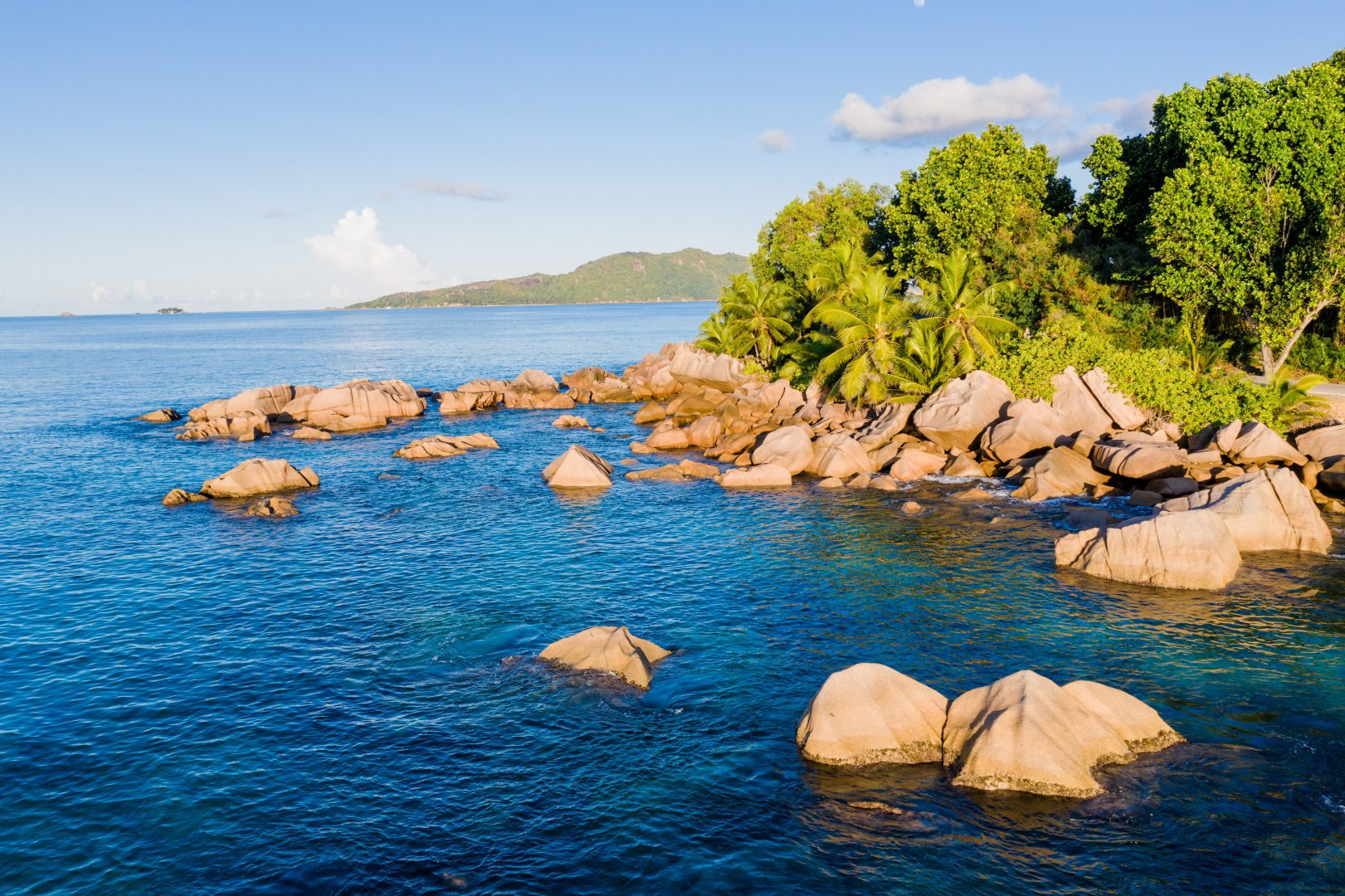 Body of water Natural landscape Sea Nature Water Coast Blue Shore Sky Ocean Rock Coastal and oceanic landforms Inlet Azure Bay Water resources Skerry Promontory Summer Cove Calm Tree Vacation Bight Beach Tropics Bank Island Watercourse Headland