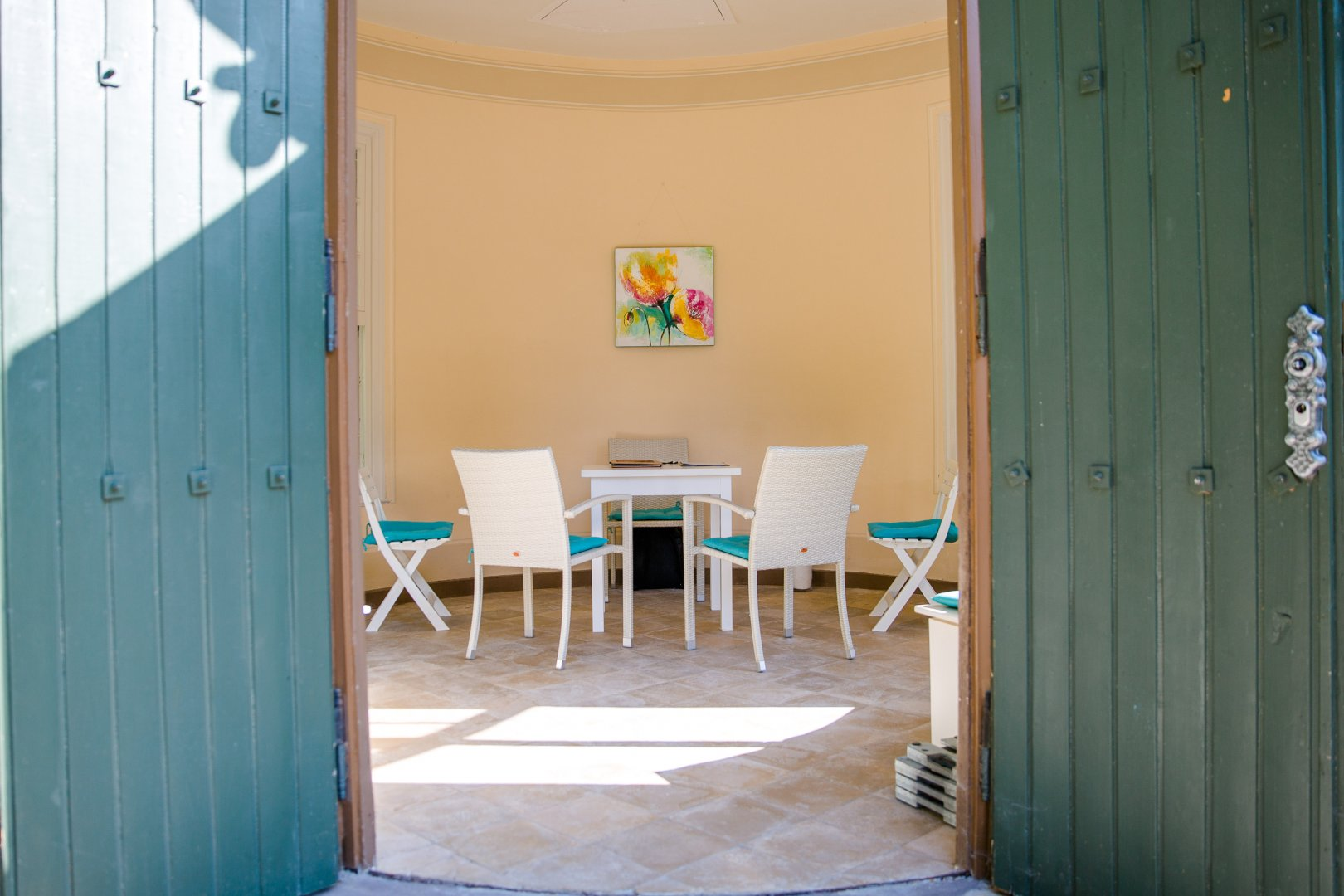 Blue Turquoise Room Property Yellow Aqua Wall House Azure Floor Interior design Furniture Building Chair Door Home Turquoise Table Wood Flooring Ceiling