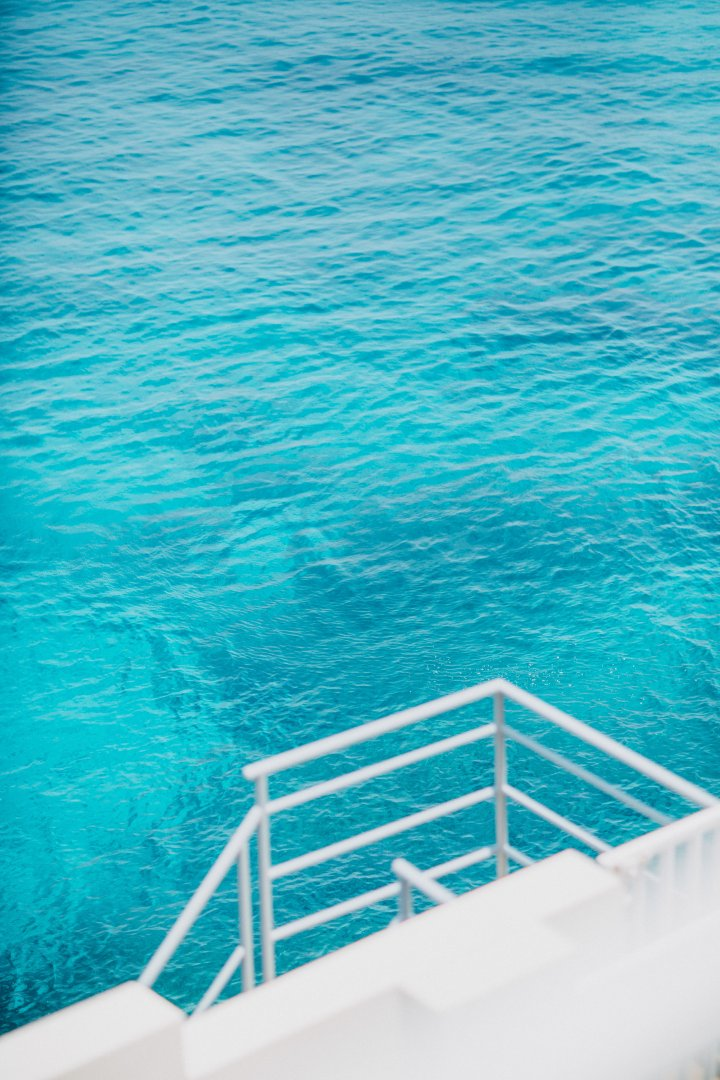 Blue Water Aqua Turquoise Sea Ocean Azure Sky Turquoise Vacation Calm Rectangle Leisure Wave Swimming pool Boat Vehicle