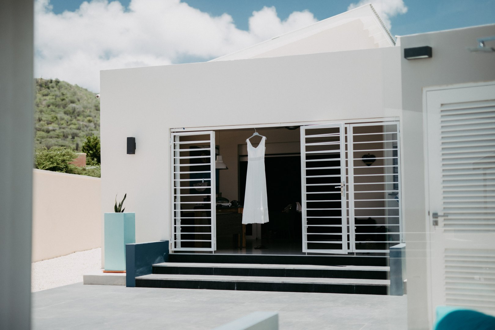 White Property Blue House Home Building Wall Architecture Window Door Real estate Room Facade Material property Interior design Residential area Shade Glass Porch Daylighting