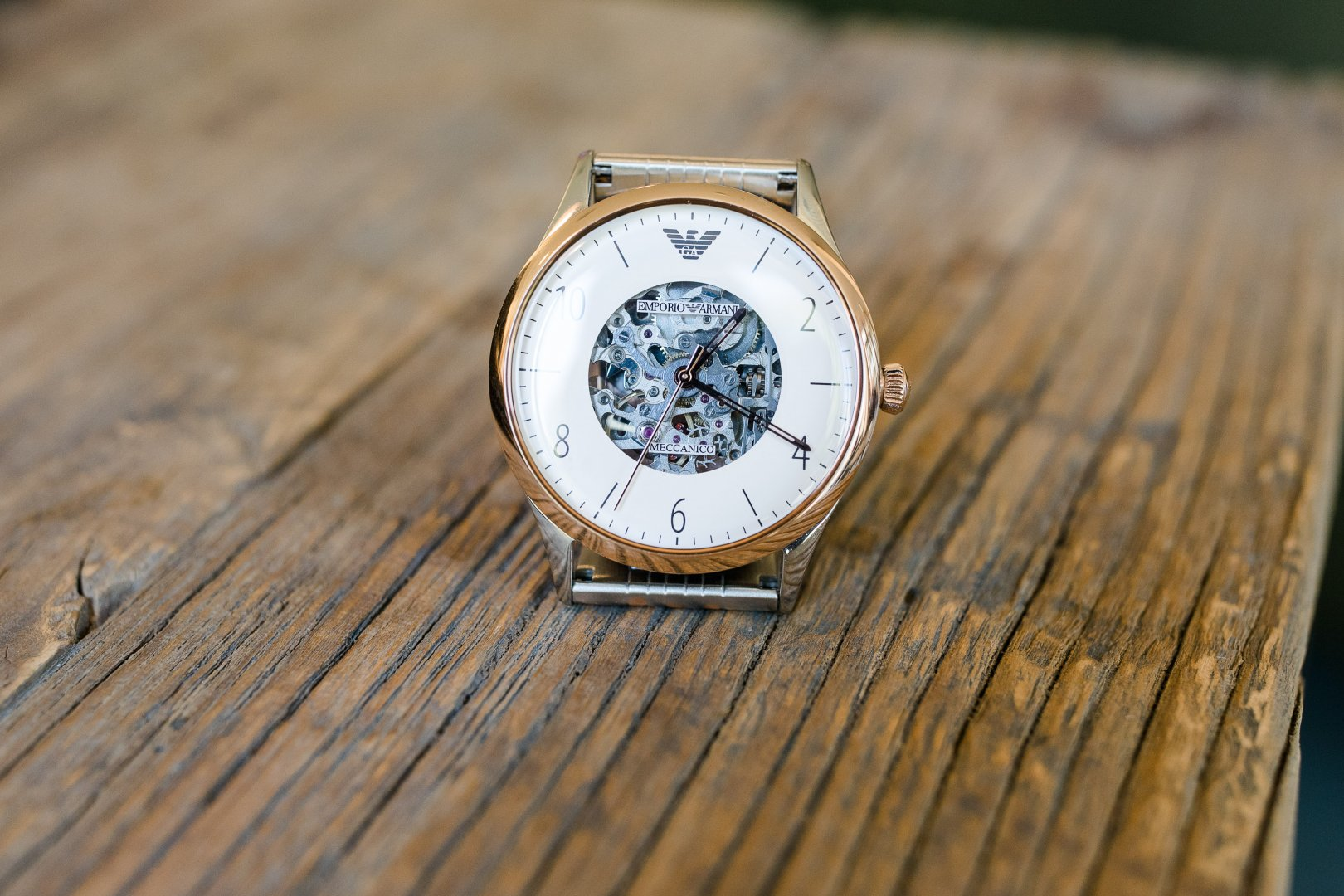 Watch Watch accessory Fashion accessory Jewellery Analog watch Close-up Material property Metal Strap Photography Wood Brand Silver Still life photography Glass