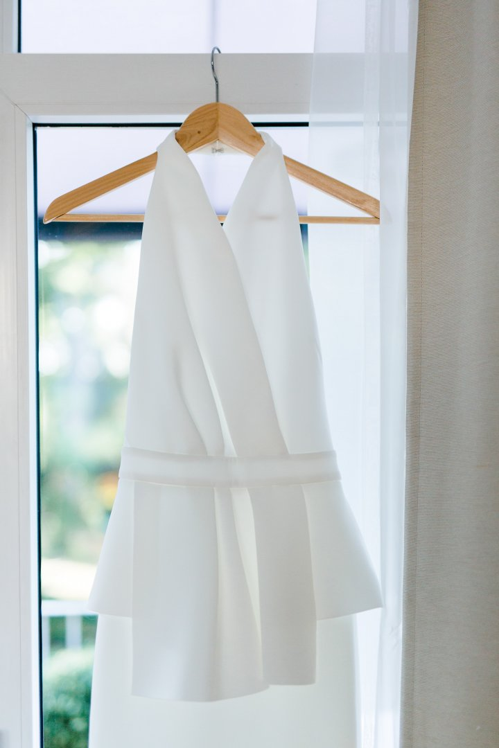 Clothes hanger White Clothing Dress Outerwear Formal wear Gown Room Bridal party dress Bridal clothing Pattern Linens Wedding dress