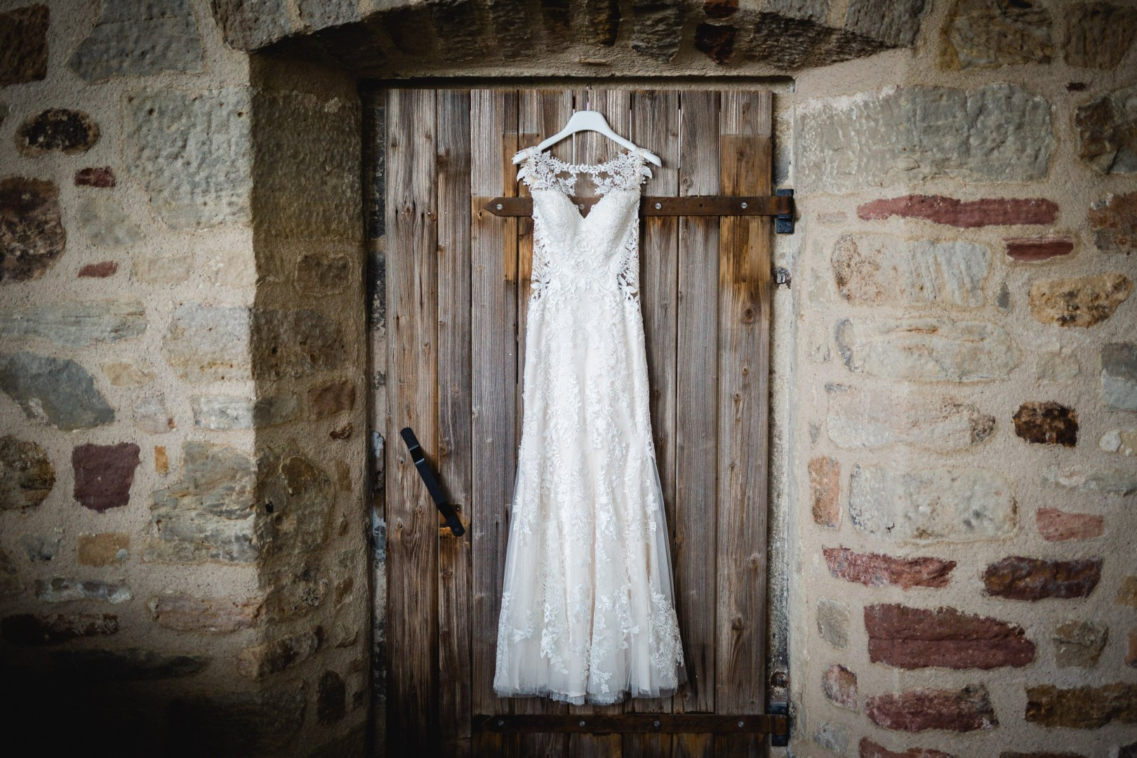 Photograph White Wedding dress Dress Clothing Gown Bridal clothing Bride Wall Fashion Bridal accessory Wood Textile Photography Ceremony Door Window Stock photography House Veil Formal wear Wedding Chapel Lace Bridal party dress Building
