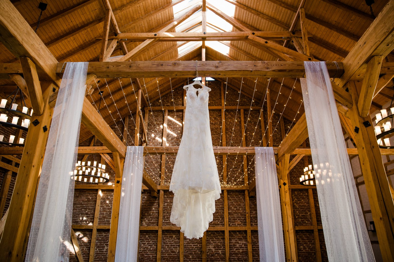 Photograph Dress Wedding dress Bridal clothing Ceiling Room Bride Aisle Ceremony Chapel Wood Place of worship Gown Wedding Beam Building