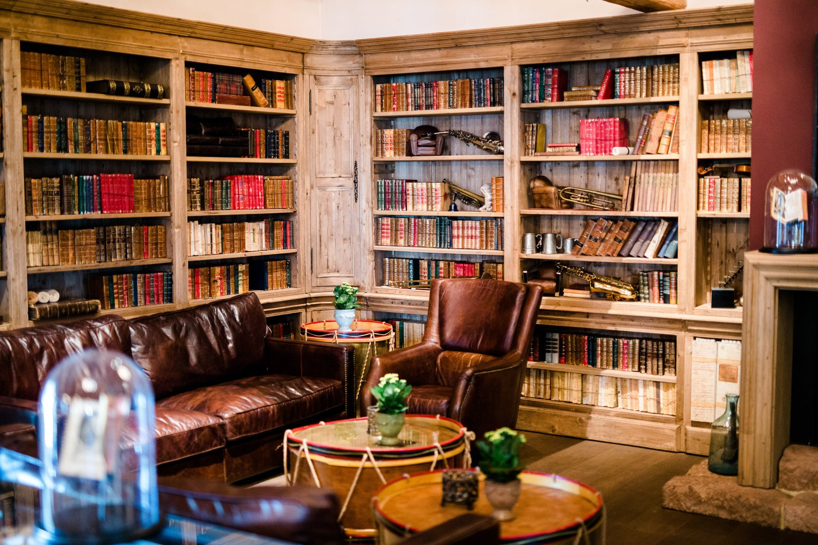 Bookcase Shelving Library Furniture Building Room Shelf Living room Interior design Bookselling Home Public library Book House Architecture Table Den Publication Couch Retail Organization