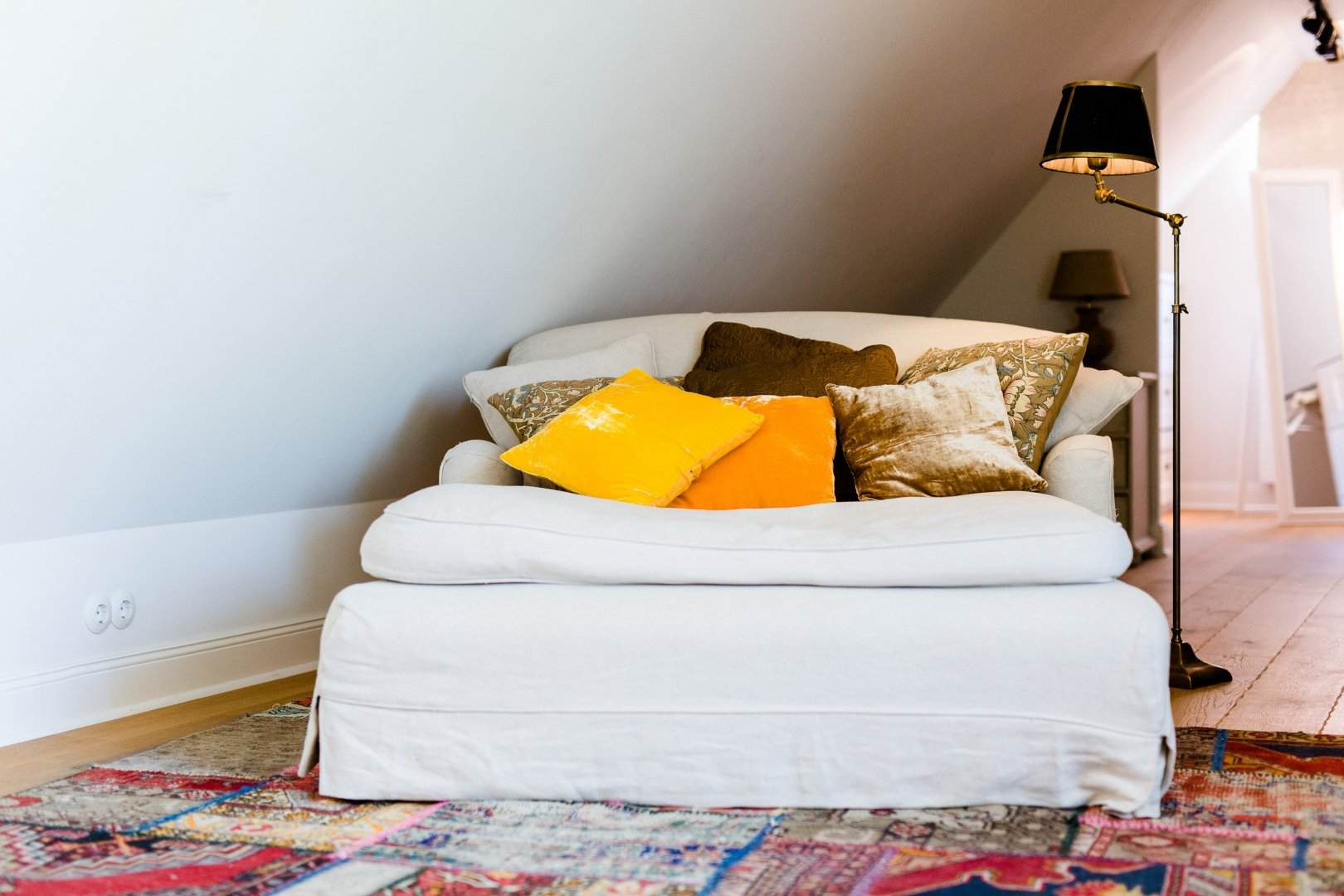 Room Furniture Yellow Bedroom Bed Property Interior design Orange Wall Bed sheet Home Comfort Living room House studio couch Bedding Couch Pillow Floor Textile Table Cushion Linens Slipcover Mattress Nightstand Boutique hotel Suite Building